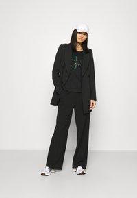 Calvin Klein Jeans - DISTORTED IRIDESCENT TEE - Print T-shirt - black - 1