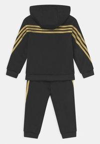 adidas Performance - SHINY SET UNISEX - Survêtement - black/gold metalic - 1
