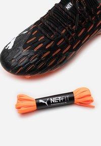Puma - FUTURE 6.1 NETFIT LOW FG/AG - Moulded stud football boots - black/white/shocking orange - 5
