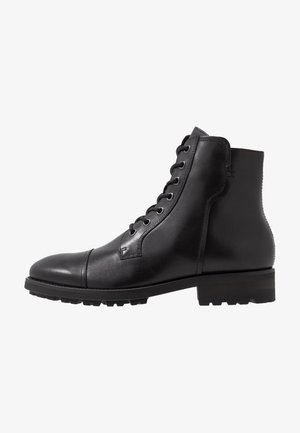 MICK - Lace-up ankle boots - black