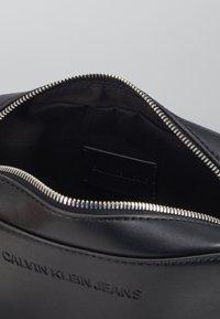 Calvin Klein Jeans - FLATPACK - Across body bag - black - 4