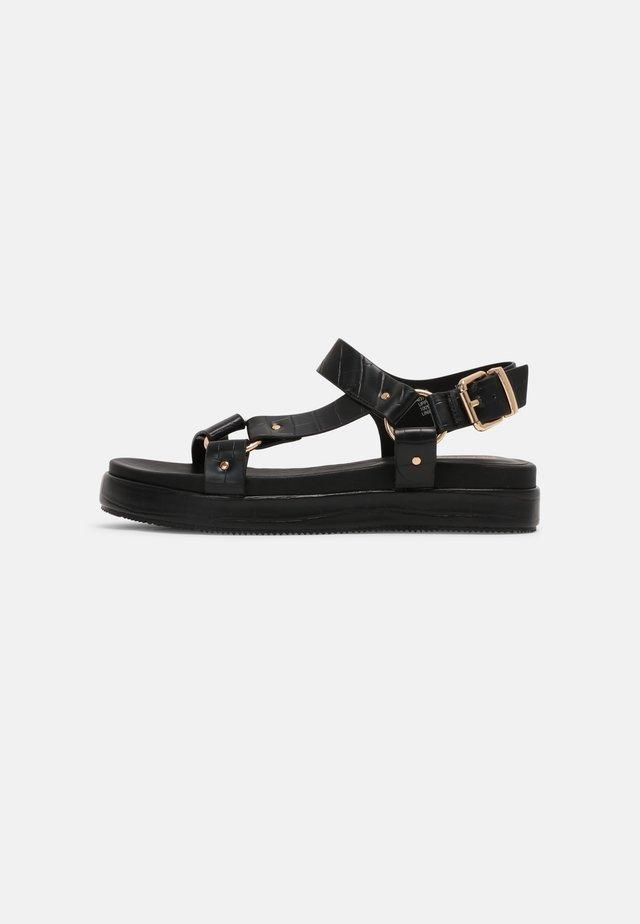 LUSSO - Korkeakorkoiset sandaalit - black