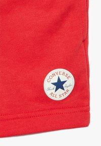 Converse - PRINTED CHUCK PATCH - Pantalon de survêtement - university red - 3