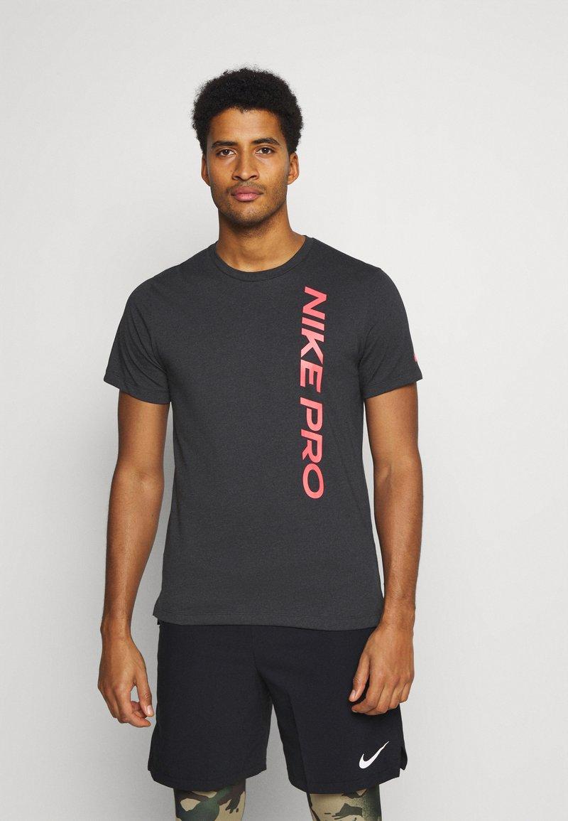 Nike Performance - BURNOUT - Print T-shirt - black/bright crimson