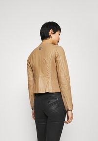 Freaky Nation - EMELLIE - Leather jacket - iced coffee - 2