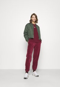 Nike Sportswear - PANT - Tracksuit bottoms - dark beetroot - 1