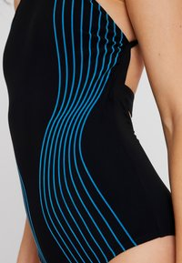 Arena - AURA LIGHT CROSS ONE PIECE SHAPEWEAR - Swimsuit - black/turquoise - 4
