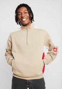 adidas Originals - MODULAR - Sweatshirt - hemp/white/power red - 0