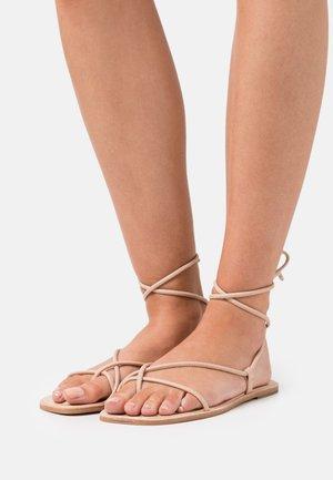 ADRAVIA - T-bar sandals - bone