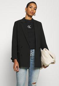 Calvin Klein Jeans - CUT OUT BACK  - Sweatshirt - black - 4