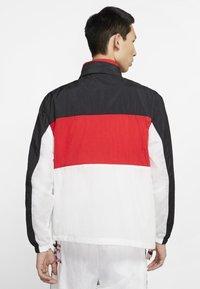 Nike Sportswear - NSW NIKE AIR  - Outdoor jacket - black/university red/white - 2