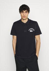 Lacoste - Polo shirt - abimes - 0