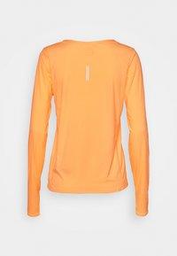 Nike Performance - CITY SLEEK - Sports shirt - melon tint/silver - 1