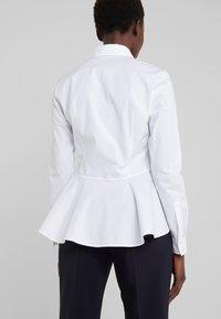 HUGO - EPANTIA - Button-down blouse - open white - 6