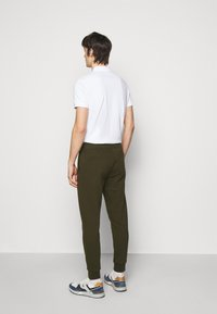 Polo Ralph Lauren - Tracksuit bottoms - company olive - 2