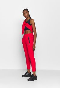 Ellesse - CANA - Tracksuit bottoms - red - 1