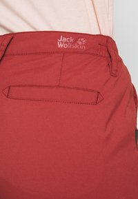 Jack Wolfskin - DESERT ROLL UP PANTS - Outdoor trousers - auburn - 3