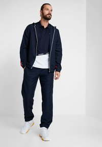 Lacoste Sport - PANT - Tracksuit bottoms - navy blue/ocean/white - 1