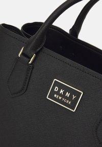 DKNY - BIANCA SATCHEL - Kabelka - black/gold - 3
