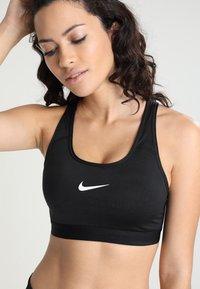 Nike Performance - CLASSIC PAD BRA - Sports bra - black/white - 4