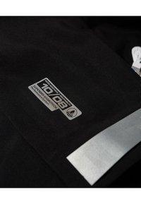 Superdry - HARPA - Waterproof jacket - black - 5