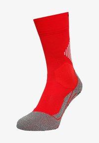 4 GRIP STABILIZING - Sports socks - scarlet