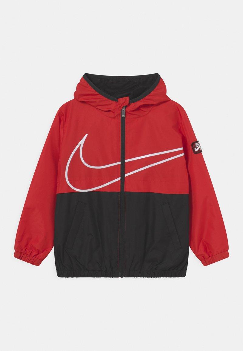 Nike Sportswear - WINDBREAKER UNISEX - Light jacket - university red