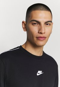 Nike Sportswear - REPEAT - Print T-shirt - black - 3