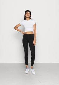 adidas Originals - TREFOIL ORIGINALS ADICOLOR LEGGINGS COMPRESSION - Leggings - black - 1