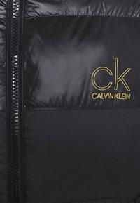 Calvin Klein - LOGO PUFFER JACKET - Down jacket - black - 3