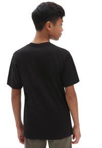 Vans - Print T-shirt - black - 0