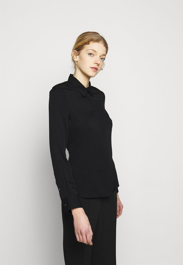 CLASSIC FITTED - Button-down blouse - black