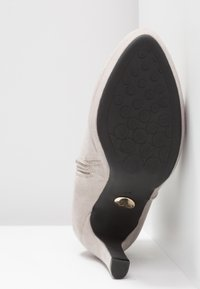 Buffalo - High heeled ankle boots - light grey - 6