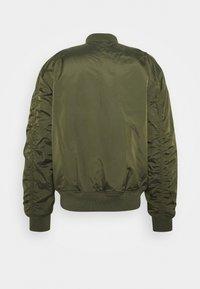 Alpha Industries - REVERSIBLE TEDDY - Bomber Jacket - dark green - 1