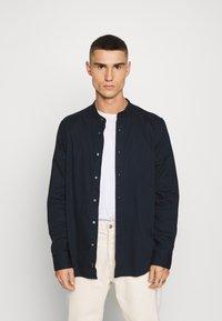 Calvin Klein - STAND COLLAR LIQUID TOUCH - Shirt - blue - 0