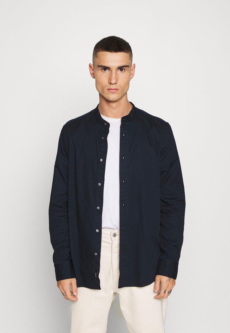 Calvin Klein - STAND COLLAR LIQUID TOUCH - Shirt - blue