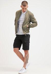 Carhartt WIP - AVIATION COLUMBIA - Shorts - black - 1