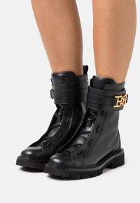 Bally - GLARIS - Cowboy/biker ankle boot - black - 0