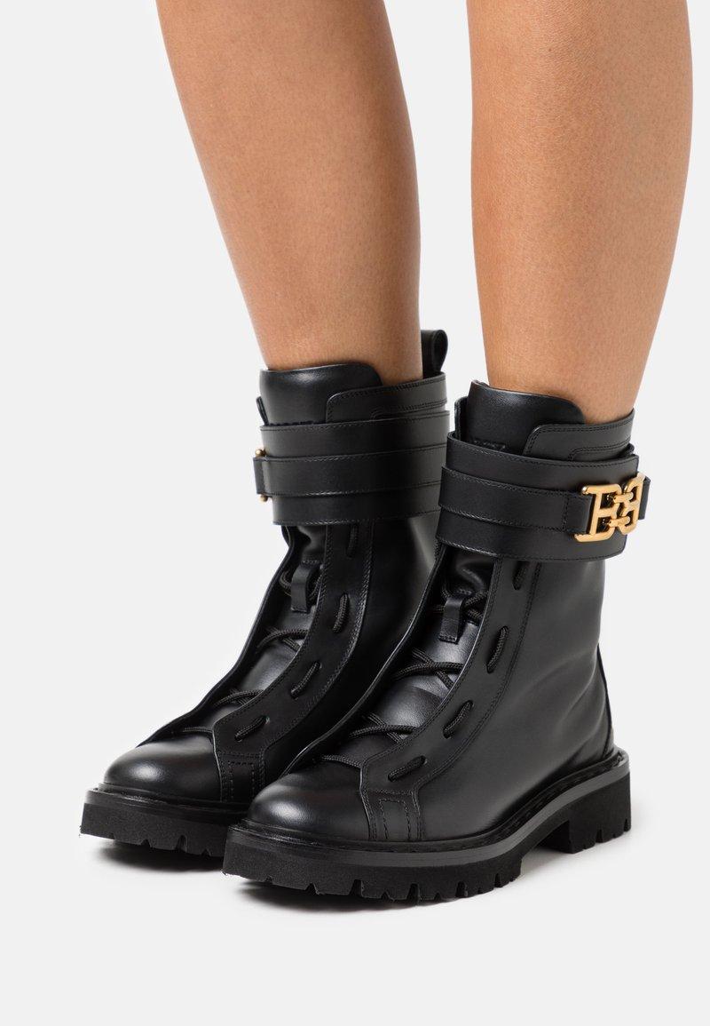 Bally - GLARIS - Cowboy/biker ankle boot - black