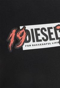 Diesel - T-shirt con stampa - black - 2