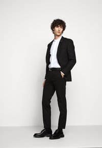 HUGO - HELDOR - Suit trousers - black - 1