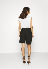 NAF NAF - COMODO - Shorts - noir - 2