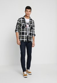 Levi's® - 512™ SLIM TAPER FIT - Jeans Tapered Fit - rock cod