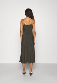 DESIGNERS REMIX - VALERIE LONG SLIP - Cocktail dress / Party dress - green - 2