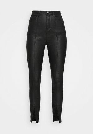 SPLIT FRONT COATED SINNER SKINNY - Trousers - black