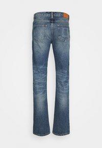 sandro - SLIM AGED - Slim fit jeans - blue vintage denim - 1