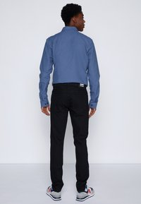 Dr.Denim - CLARK - Jeans Tapered Fit - black - 2