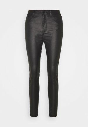 WET LOOK SKINNY - Trousers - black