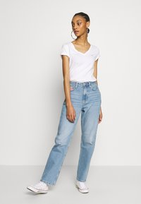 Tommy Jeans - HARPER STRGHT - Straight leg jeans - light blue denim - 1