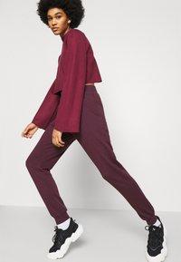 New Look - SLIM LEG JOGGER - Tracksuit bottoms - dark burgundy - 3